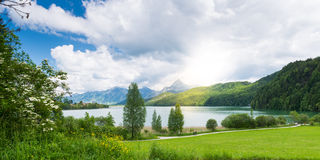 Lake weissensee in bavaira with sun Royalty Free Stock Photography