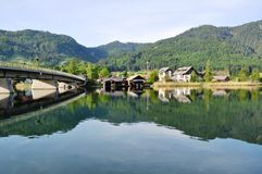 Lake Weissensee with Bridge, Austria. Image shows panoramic view to lake Weissensee with bridge in Austria, Techendorf, Carinthia Stock Photo