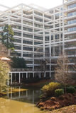 Lake by White Terraced Office Building Royalty Free Stock Photo