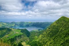 Lagoa Azul lake, Sao Miguel island, Azores, Portugal. Lake in wide volcanic crater, called Lagoa Azul in Portuguese, surrounded by green mountains of Sete royalty free stock photography