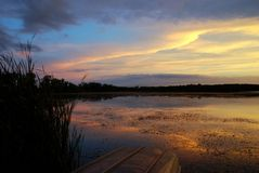 Lake Wingra Sunset Overlooking University of Wisco. Facing south from an area adjacent to Vilas Beach in Madison, Wisconsin.  August 2014.  Sunset Royalty Free Stock Image