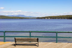 Lake Winnepesaukee in New Hampshire, United States. A bench at the shore of Lake Winnepesaukee in New Hampshire, United States Stock Photos