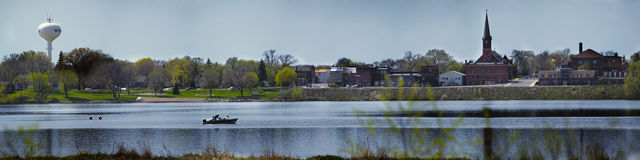 Lake Winsted. This is a panorama of Lake Winsted in the summertime.  The scene includes the town, lake and boater Stock Images