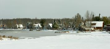 Lake in Winter. Lakefront cabins during an Alberta, Canada winter Royalty Free Stock Images