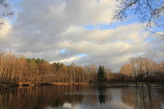 Lake at winter time by sunny weather Royalty Free Stock Photography