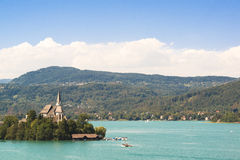 Lake Woerthersee with island and church in Austria Stock Photography
