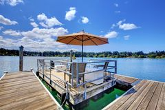 Lake with wood pier and private party raft. Lake with long wood pier and private party raft. summer sunny day Stock Photography