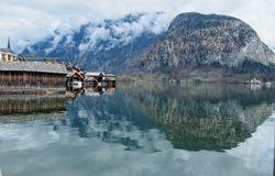 Lake Wood and Reflection. Calm blue lake in Hallstatt Stock Image