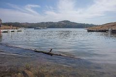 Lake with wood trunk floating. royalty free stock photography