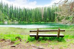 Lake and wooden bench Royalty Free Stock Photo