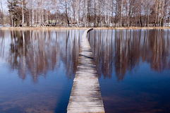 Lake and wooden footbridge Stock Photo