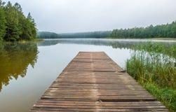 Lake and wooden footbridge Royalty Free Stock Image