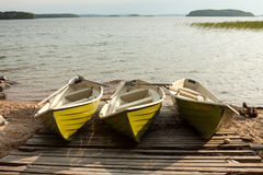 Three boats. Lake with a wooden pier and a three boats in Finland Royalty Free Stock Images