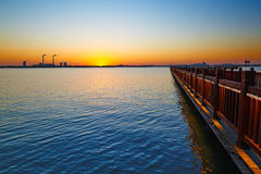 The lake and wooden trestle sunset Royalty Free Stock Image