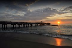 Lake Worth Pier. Lake Worth fishing pier and beach at sunrise in Lake Worth, Florida Stock Image