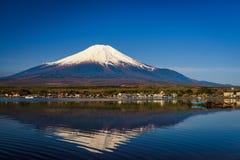 Lake Yamanaka with Mount Fuji. San or Fuji, Yamanashi, Japan. Natural scenic landscape with skyline reflection on water. Famous travel destination with copy stock photo