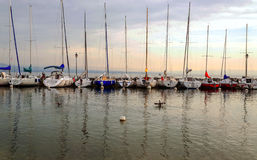 Lake yvoire in France. With boats on a cloudy day Royalty Free Stock Photos