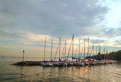 Lake yvoire in France. With boats on a cloudy day Royalty Free Stock Photo