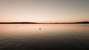 Lake Zug. Gorgeous evening.  Sunset colors  sky and  Lake Zug in central Switzerland Royalty Free Stock Photos
