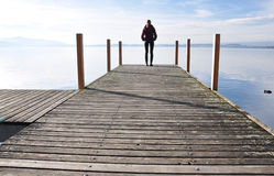Lake of Zug, Switzerland. Girl on the pier. Lake of Zug, Switzerland Royalty Free Stock Photography