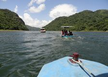 Lakefari. Boats traveling by the Hanabanilla lake, Cuba Royalty Free Stock Images