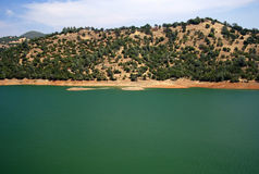 Lakefront. One of several small lakes along the foothills of the Sierra Nevada Royalty Free Stock Photo