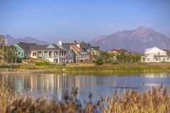 Lakefront homes along Oquirrh Lake on a sunny day royalty free stock photo