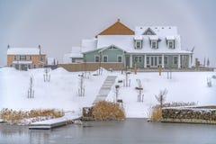 Lakefront homes in Daybreak Utah viewed in winter royalty free stock images