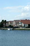 Lakefront homes with water view stock images
