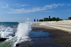Lakefront Surf Under Cirrus Clouds Stock Image