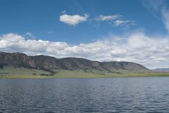 A lakefront view of Sheep mountain from Lake Hattie, Laramie, Wyoming. Snowy Range Mountains, Medicine Bow- Routte National Forest royalty free stock images
