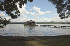 Lakefront yard with boathouse and sky Royalty Free Stock Photography