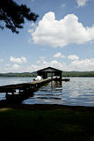 Lakefront yard with boathouse and sky Royalty Free Stock Photos