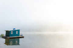 Lakehouse in fog Royalty Free Stock Photos