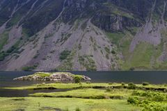 Lakeland - Wasdale. Under a grey lakeland sky Wastwater Screes descend into Wastwater, the deepest lake in England, Wasdale, The Lake District, Cumbria, UK Royalty Free Stock Photo