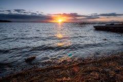 lakeonega solnedgång royaltyfri foto