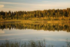 Sunset on the lake in the autumn. Laker landscape on a background of a decline in autumn Royalty Free Stock Photos