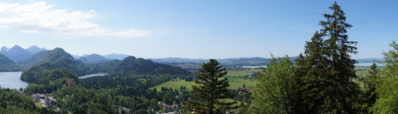 Lakes in Bavaria (panorama). Bavaria from above. Picture was made from Neuschwanstein Castle. View of Hohenschwangau Castle & Swan Lake from Neuschwanstein Stock Photography