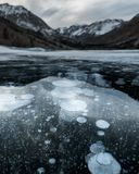 Ice bubbles on a frozen lake in California