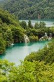 Lakes with cascades among mountains Stock Photos