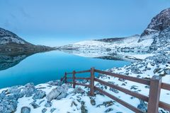 The lakes of Covadonga!. The lakes of Covadonga, snow-capped, in total calm, showing the reflected symmetry of the hills in the same lake royalty free stock photo