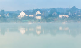 Lakes and the early morning fog. Mystic fog is running on the lake in the cold summer morning royalty free stock images