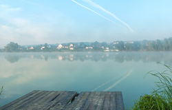 Lakes and the early morning fog. Mystic fog is running on the lake in the cold summer morning. Bridge Lake stock image