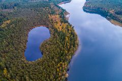 Aerial lake photography. Lakes in forest, aerial photography of beautiful Lithuanian scenic nature in autumn season stock images
