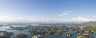 Lakes and islands at Guatape in Antioquia, Colombia. Panorama of the lakes and islands in Guatape taken from Piedra el Penol with blue sky, near Medellin Royalty Free Stock Photo