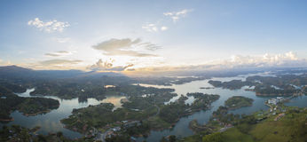 Lakes and islands at Guatape in Antioquia, Colombia. Panorama of the lakes and islands in Guatape taken from Piedra el Penol with sunset clear sky, near Medellin Stock Photos