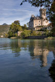 Lakes land. Middle-aged castle on a lake Annecy bank on a bright day Stock Photo