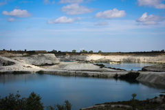 Lakes in limestone quarry. Royalty Free Stock Images