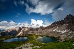 Lakes near surrounded by mountains, Dolomites, Italy Stock Photos