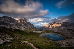 Lakes near surrounded by mountains, Dolomites, Italy. A beautiful long exposure image of two nice blue/green mountainlakes in the Dolomites, Italy stock photo